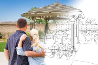 two people seeing their pergolas completed by Geelong Carports